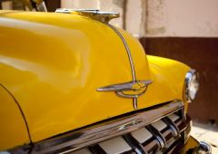 Cubana Production Service Cuba Photo yellow car
