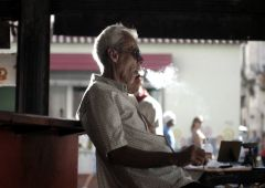 smoking man in bar