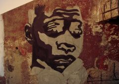 old street art on stone wall