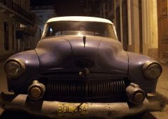 old blue car in the night