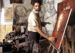 painting artist in his gallery studio