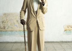 old man with cane in yellow costume