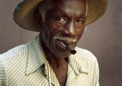 man in hat smoking a cigar