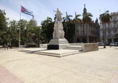 white marbel statue and the cuba flag
