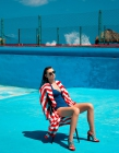 cubana_productions_woman sitting in blue pool