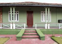 Font door green wooden house