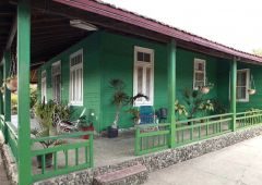 Green woodenhouse in Havana cuba